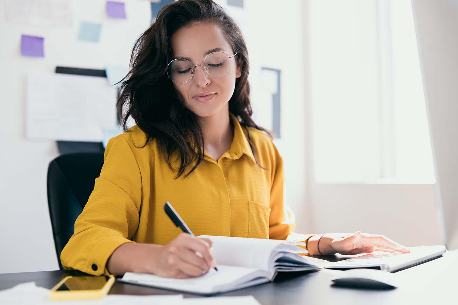 Woman at Desk Writing