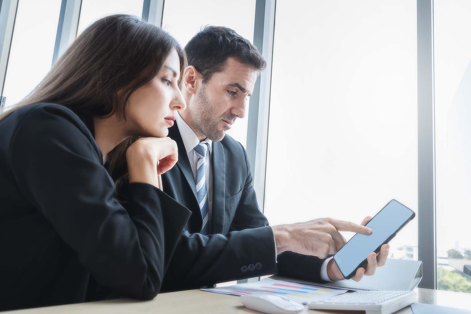 Business Man and Woman Reviewing Document