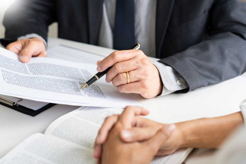 People Discussing a Legal Document